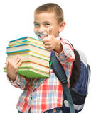 Cute boy is holding book Stock Photo