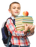 Cute boy is holding book. Education concept, isolated over white Stock Image