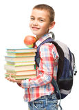 Cute boy is holding book. Education concept, isolated over white Royalty Free Stock Photo
