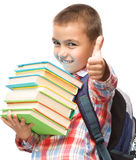 Cute boy is holding book. Education concept, isolated over white Royalty Free Stock Image