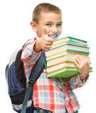 Cute boy is holding book Stock Photography