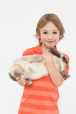 Cute boy holding bunny on white background Royalty Free Stock Photography