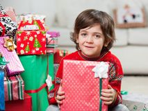 Cute Boy With Holding Christmas Present Stock Image