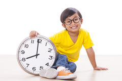 Cute boy  holding  clock Royalty Free Stock Image