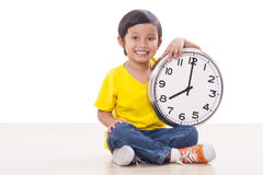 Cute boy  holding  clock Royalty Free Stock Photography