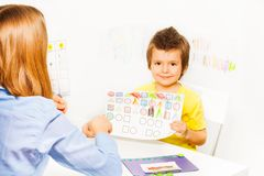 Cute boy holding the drawing with colored shapes Stock Photo