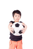 Cute boy is holding a football ball. Isolated on a white background (selective focus Royalty Free Stock Photography