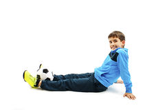 Cute boy is holding a football ball made of genuine leather. Isolated on a white background. Soccer ball Royalty Free Stock Photos