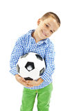 Cute boy is holding a football ball made of genuine leather. Soccer ball Royalty Free Stock Photos