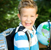 Cute boy is holding globe. Education concept Stock Image