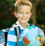 Cute boy is holding globe. Education concept Royalty Free Stock Images