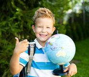 Cute boy is holding globe. Education concept Royalty Free Stock Photo