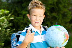 Cute boy is holding globe. Education concept Royalty Free Stock Image