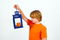 Cute boy holding a hand lantern Stock Photos