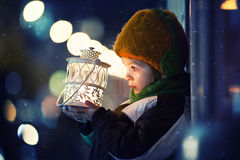 Cute boy, holding lantern outdoor Stock Images