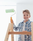 Cute boy holding a paint roller Royalty Free Stock Photography
