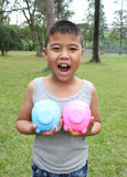 Cute boy holding piggy bank Royalty Free Stock Images