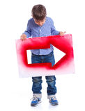 Cute boy holding red arrow Stock Photos