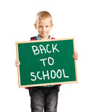 Cute boy holding a sign saying Back to school Royalty Free Stock Photography