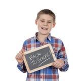 Cute boy holding slate Stock Photos