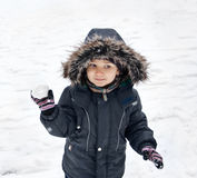 Cute boy holding snowball Stock Image