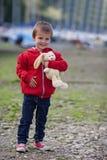 Cute boy, holding teddy bear on a harbor Stock Image