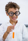 Cute boy holding test tube with liquid at laboratory Royalty Free Stock Photography