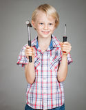 Cute boy holding tools Royalty Free Stock Photos