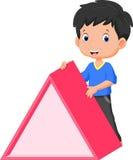 Cute boy holding a triangle Stock Photo