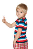 Cute boy holds his thumb up Royalty Free Stock Photos