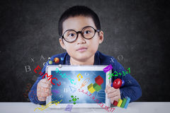 Cute boy holds tablet with formula Stock Image