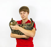 Cute boy hugging his tabby cat Royalty Free Stock Images