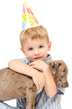Cute boy hugging a pit bull puppy Royalty Free Stock Photo