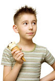 Cute boy with ice cream. In his hand isolated on white Royalty Free Stock Photography