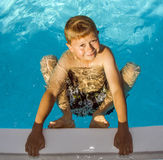 Cute Boy In Swimming Pool Laughes Royalty Free Stock Images