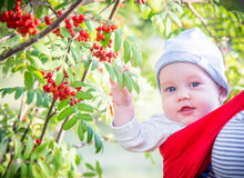 Cute boy infant in park smiling Royalty Free Stock Photography