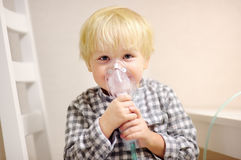 Cute boy inhalation therapy by the mask of inhaler Royalty Free Stock Photography
