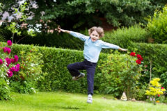 Cute boy jumping in the garden Stock Photo