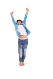Cute boy jumping up and smiling Stock Photo