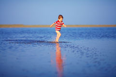 Cute boy kid running the lake Stock Photos