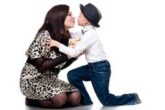 Cute boy kissing his mother Stock Photos