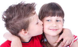 Cute boy kissing a nice girl Stock Image