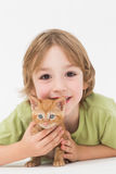 Cute boy with kitten over white background Stock Images