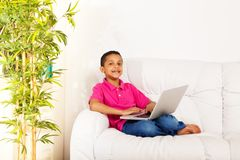 Cute boy with laptop Stock Images