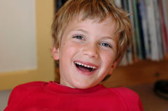 Cute boy laughing. Close-up natural portrait of young boy laughing Royalty Free Stock Photo