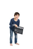 Cute boy is laughing keeping clapperboard Royalty Free Stock Photos