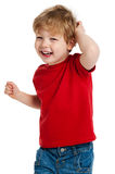 Cute Boy Laughing. Smiling happy boy in red T shirt shot in the studio on a white background Royalty Free Stock Photos