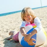 Cute boy laying on beach ball. Stock Images