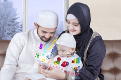 Cute boy learning with his muslim parents Royalty Free Stock Images