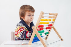Cute boy, learning to count and math Royalty Free Stock Image